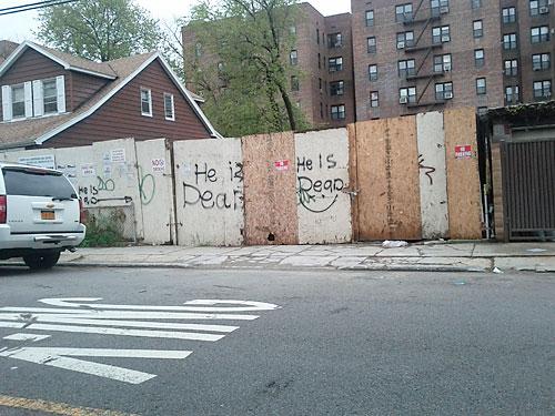 'He is dead' graffiti
