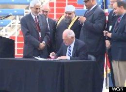 Pat Quinn signing bill