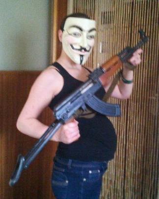 Stella Evans posing with gun