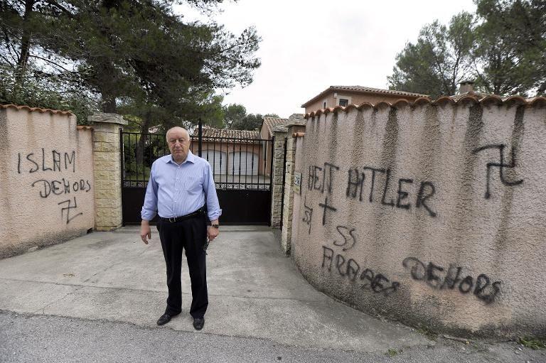 Abdallah Zekri with racist and fascist graffiti