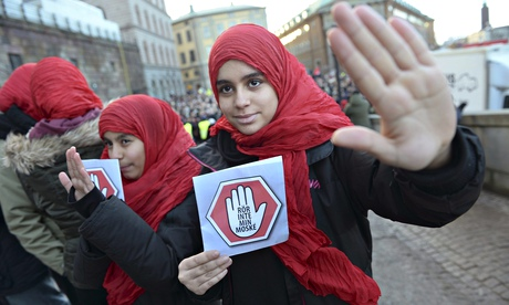 Girls bear leaflets reading: 'Don't touch my mosque' at a demonstration in Stockholm, Sweden