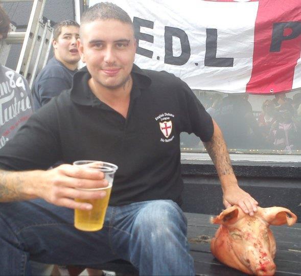 Kieran Hallett with pig's head
