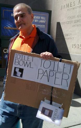 Koran toilet paper placard