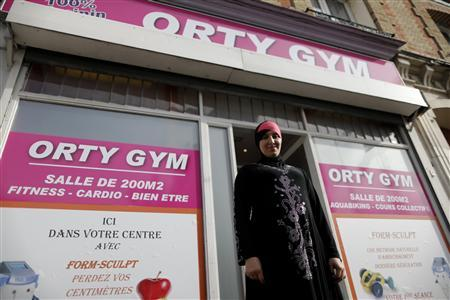 Orty Gym owner Lynda Ellabou poses in font of her new all-women's gym on the outskirts of Paris, in Le Raincy